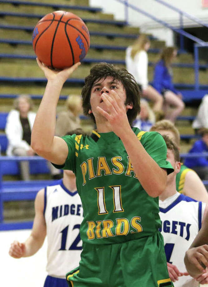Southwestern's Gavin Day (11) puts a shot after getting to the basket in a Feb. 23 game at Freeburg. On Wednesday night, the Piasa Birds were home in Piasa and defeated Mount Olive. Photo: Greg Shashack / The Telegraph