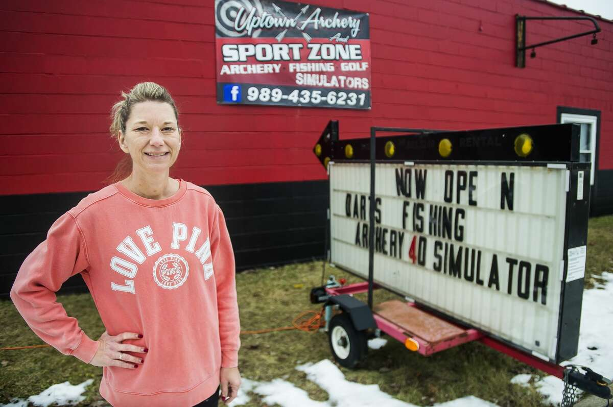 Angie Mitchell, owner of the newly opened Uptown Archery and Sports Zone, poses for a portrait in front of the business Thursday, Jan. 30, 2020 in Beaverton. (Katy Kildee/kkildee@mdn.net)