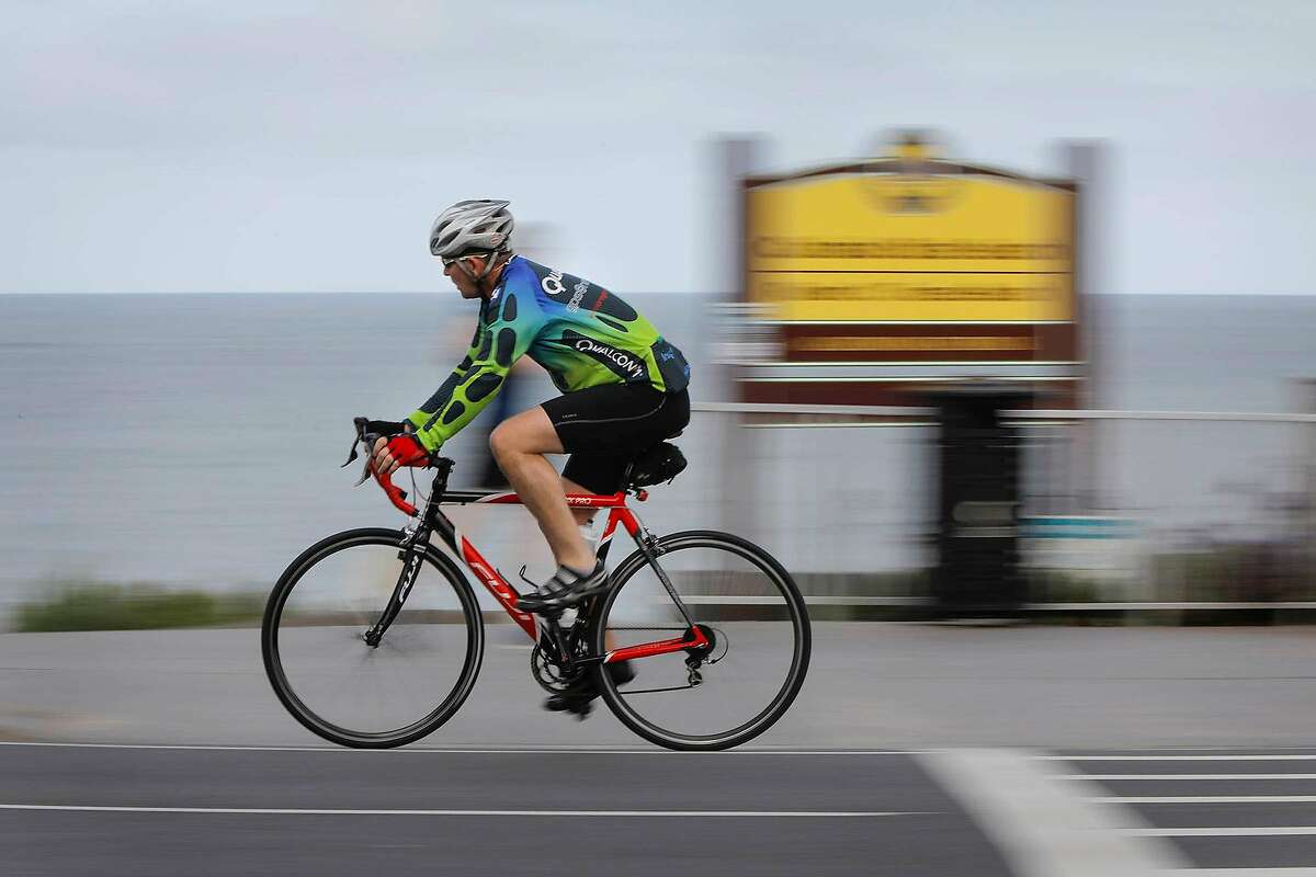 A bicyclist rides along Carlsbad Boulevard at Pine Avenue in Carlsbad, Calif., on May 17, 2018. (Howard Lipin/San Diego Union-Tribune/TNS)