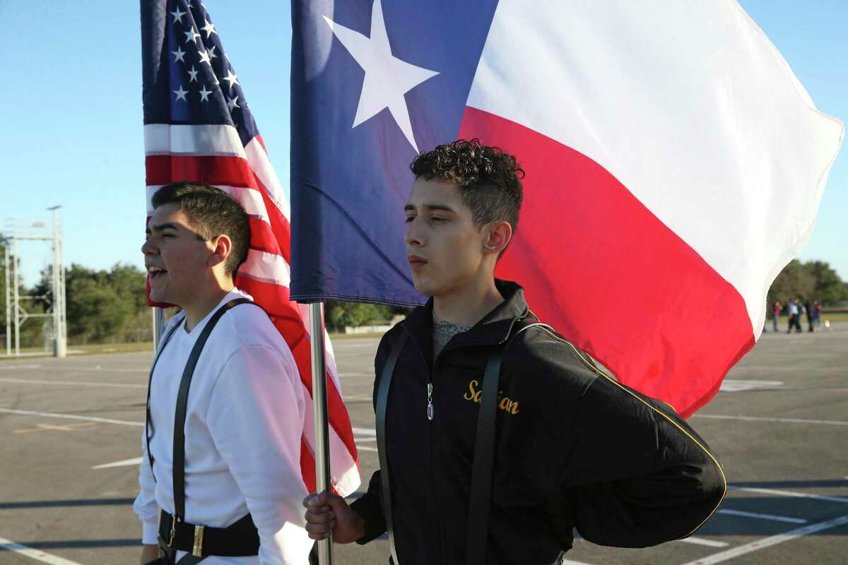 Kevin Rodriguez, left, and Fabian Lopez go through a routine as the East Central High School JROTC color guard practices Jan. 29 for a national competition. Set for March in Richmond, Va., the championships were canceled due to the coronavirus pandemic. Rodriguez is going to Embry-Riddle Aeronautical University in the fall.