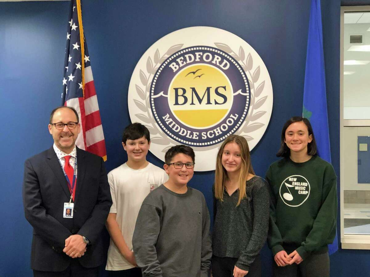 Bedford Middle School Principal stands next to Reflections Program art contest winners, from left, Jonathan Costello, Ryder Levine, Scarlet Gerber and Courtlyn Crombie.