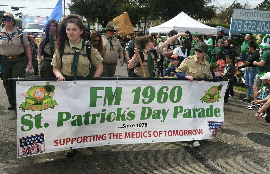 The Baby Axes Patrol of Troop 444 in Houston, led by banner carriers Ava Burre, 12, left, a 7th grader at Doerre Inter., and Meri Satterfield, 14, a freshman at Klein Forest High School, march at the front of the 2019 FM 1960 St. Patrick's Parade held on FM 1960 in Spring on March 17, 2019. Photo: Jerry Baker, Houston Chronicle / Contributor / Houston Chronicle