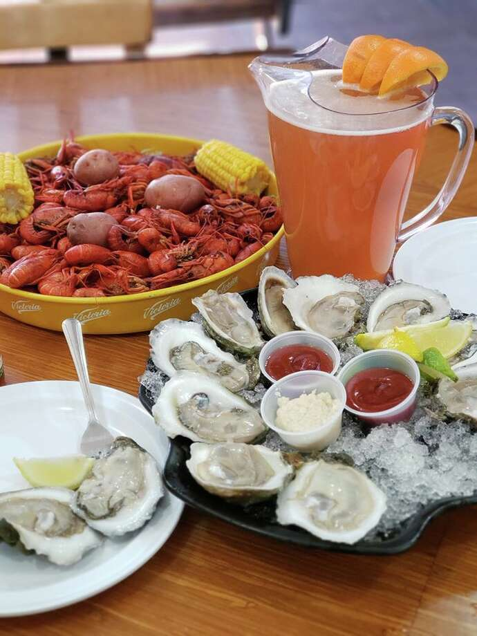 Dry Dock Oyster Bar is offering a dozen oysters, three pounds of crawfish and a pitcher of beer for $54 to celebrate the Super Bowl. The offer is valid all day Sunday. Photo: Courtesy, Dry Dock Oyster Bar