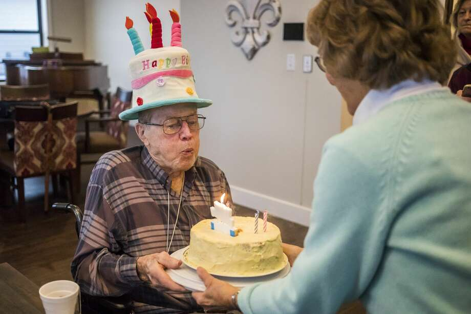 Sylvia Patchin, right, presents a birthday cake to Richard Heiny, left, during a 90th birthday party for Heiny, which was organized as part of a local birthday club, Wednesday, Jan. 15, 2020 at Primrose Retirement Community. (Katy Kildee/kkildee@mdn.net) Photo: (Katy Kildee/kkildee@mdn.net)