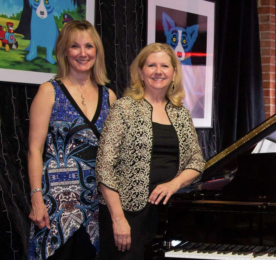Allyson Ayton and Terry Husbands Giles are chairing the YTA Bach, Beethoven &Barbecue charity gala for the second consecutive year. This year's gala takes place Saturday, March 14, in downtown Conroe. Photo: Photo By Brad Meyer
