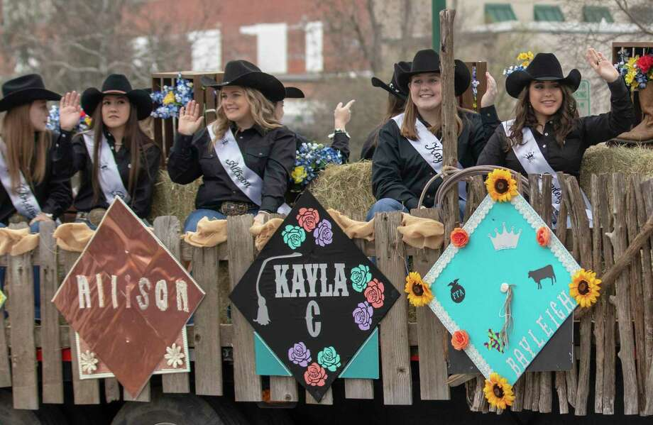 The 2019 Montgomery County Fair Queen candidates waves to spectators during the 54th annual Go Texan Parade on Saturday, Feb. 16, 2019 in Conroe. This year's parade is Saturday, Feb. 22, at 1 p.m. in downtown Conroe. Photo: Cody Bahn, Houston Chronicle / Staff Photographer / © 2018 Houston Chronicle