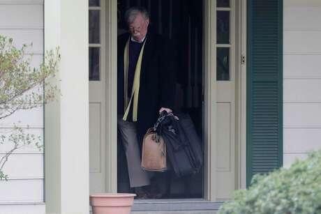 Former National security adviser John Bolton leaves his Maryland home Jan. 28.