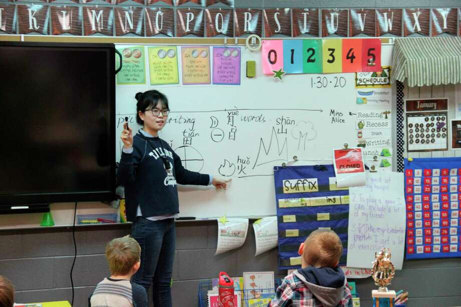 Lyu Chuanjing, known by Laker Elementary students as Ms. Alice, teaches a first grade class Mandarin Chinese words. She and another Chinese teacher are visiting Laker Elementary School for three weeks. (Robert Creenan/Huron Daily Tribune)