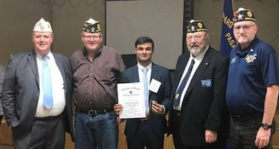 Rehan Rupawalla of Tompkins High School from American Legion Post 164 Katy won the 2nd Division Oratorical Contest held at American Legion Post 521 in Pasadena on Jan. 25. From left are 2nd Division Commander Bryan Douglas Coleman; 22nd District Commander Joseph Thomas; Rehan; 22nd District Vice Commander Harry Woodstrom, chair of the Oratorical Committee for Post 164; and Post 164 Commander Jim McGuire. Photo: Courtesy Katy American Legion Post 164 / Courtesy Katy American Legion Post 164