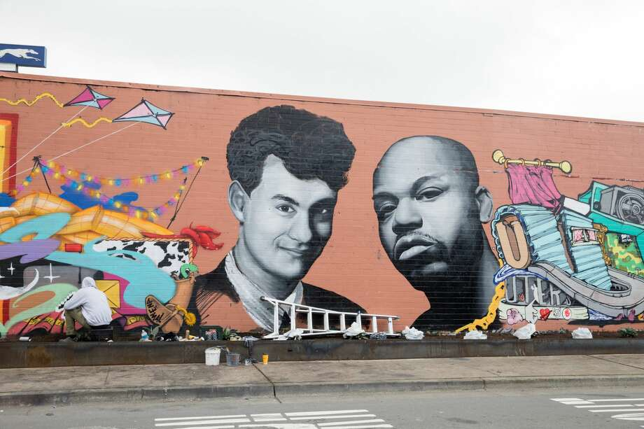 A mural honoring actor Tom Hanks, Skyline high school grad, and Oakland rapper Too $hort is being put up by artists Pierre BellaFontéand Charles Meck at the corner of San Pablo and Castro Street near the Oakland Greyhound station. Photo: Douglas Zimmerman/SFGate