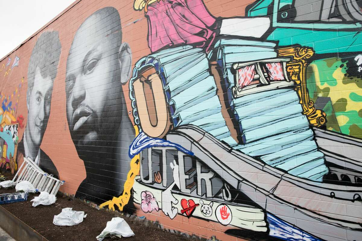A mural honoring actor Tom Hanks, Skyline high school grad, and Oakland rapper Too $hort is being put up by artists Pierre BellaFonté and Charles Meck at the corner of San Pablo and Castro Street near the Oakland Greyhound station.
