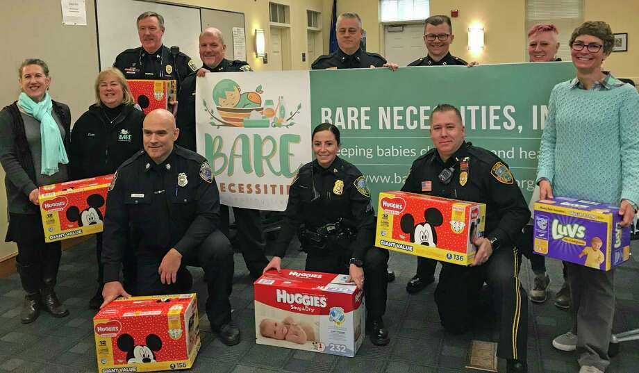 Police officials from Clinton, Guilford, madison and Branford are picturd with staff from Bare Necessities showing off the donations from 2019's diaper drive. Photo: Hearst Connecticut Media File