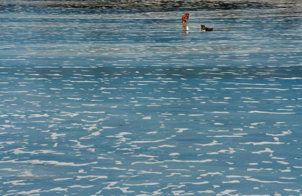 A man fishes on the ice on Racquet Lake on Thursday, Jan. 30, 2020, in West Sand Lake, N.Y. (Paul Buckowski/Times Union)