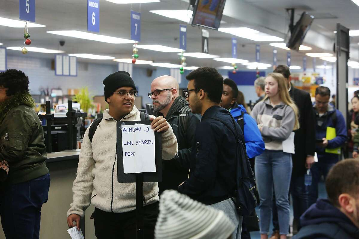 Elias Dubaie (l to r) of San Francisco talks with Kahlai Pratt of San Francisco as they wait in line to apply for the Real ID at the DMV on Fell Street on Friday, January 24, 2020 in San Francisco, Calif.
