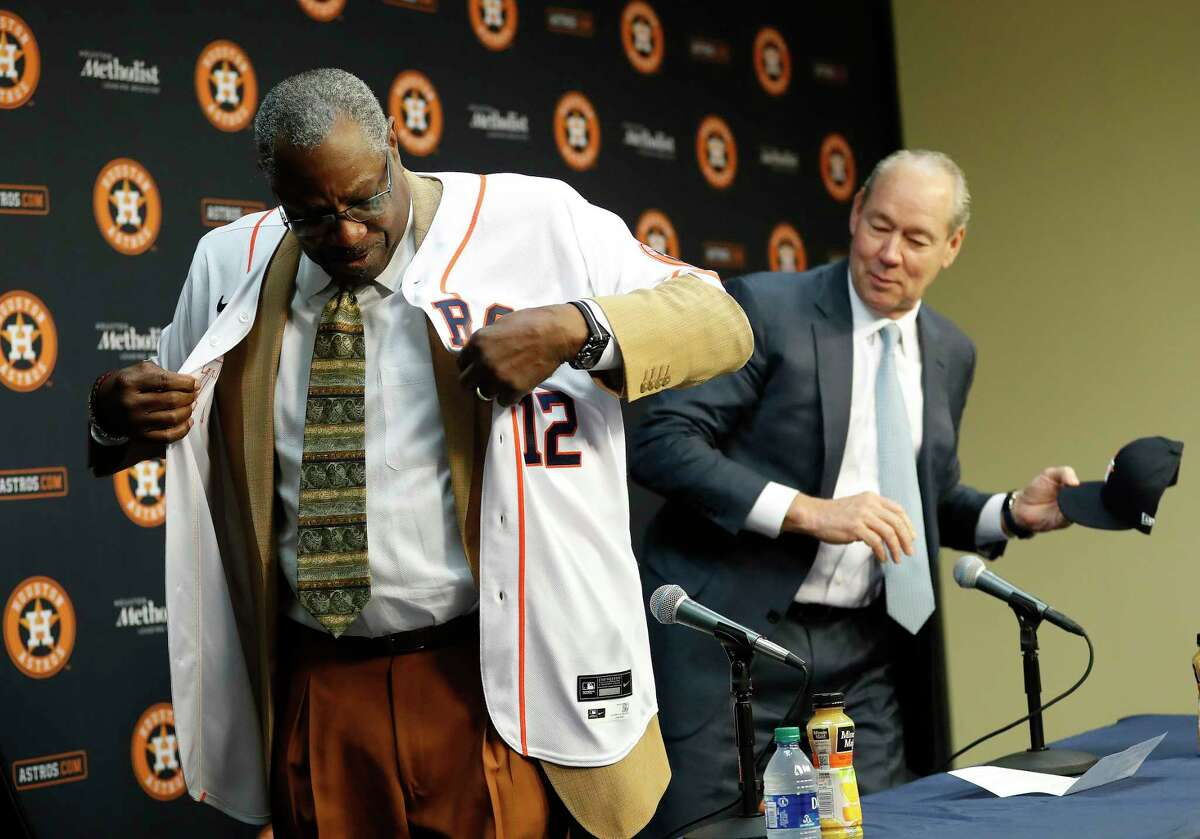 Dusty Baker puts on his Houston Astros jersey with the help of owner Jim Crane, as he was introduced as the Astros new manager at Minute Maid Park, in Houston, Thursday, Jan. 30, 2020.
