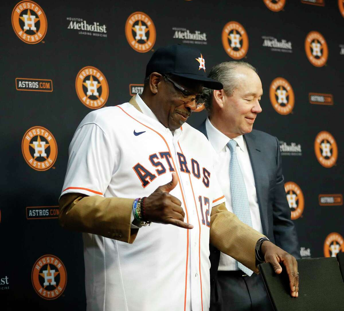Dusty Baker reacts after putting on his Houston Astros baseball cap, as owner Jim Crane introduced him as the Astros new manager at Minute Maid Park, in Houston, Thursday, Jan. 30, 2020.