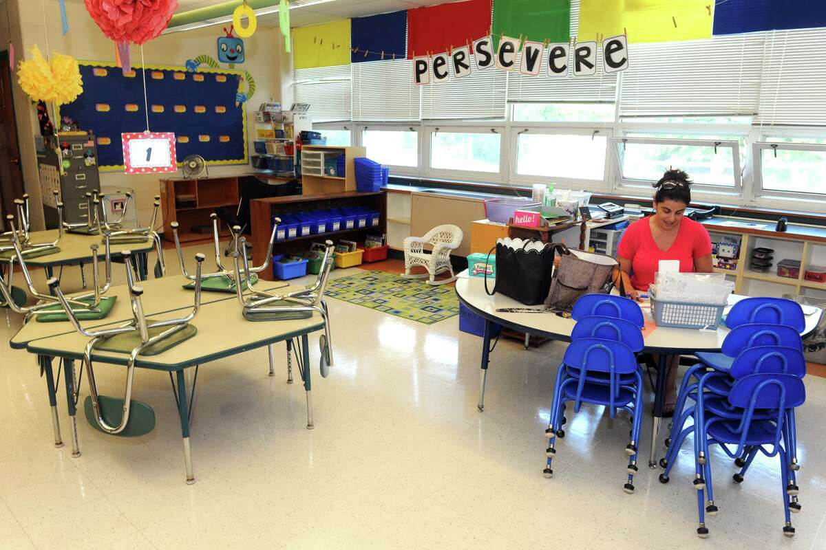 Dena O'Neill works in her kindergarten classroom at Chapel Street Elementary School in Stratford, Conn. Aug. 25, 2017. Schools open in Stratford on Thursday.