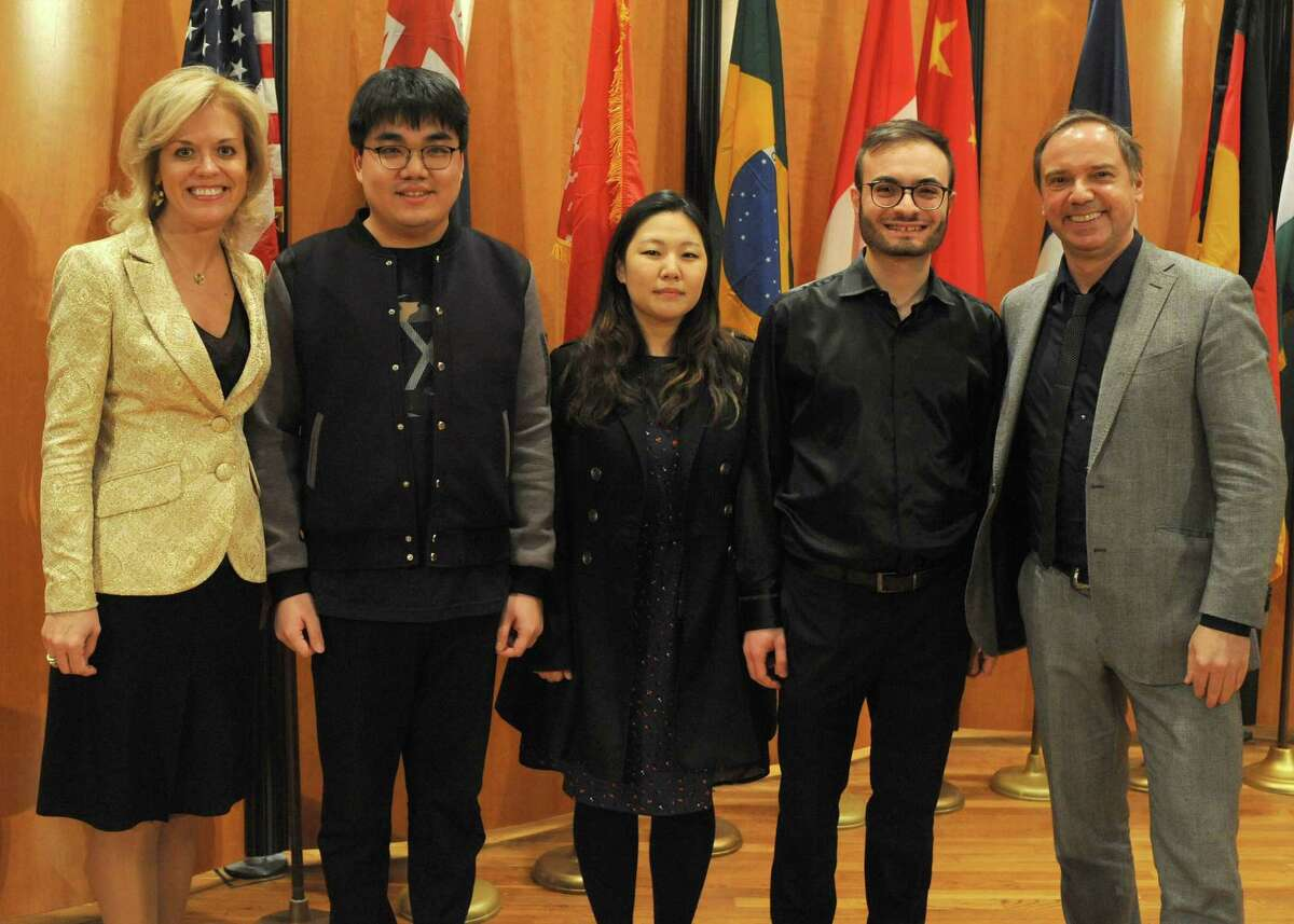 Judges Olga Kern (left) and Sebastian Lang-Lessing flank the three finalists in the Gurwitz International Piano Competition: Jiale Li (from left), Yedam Kim and Leonardo Colafelice.