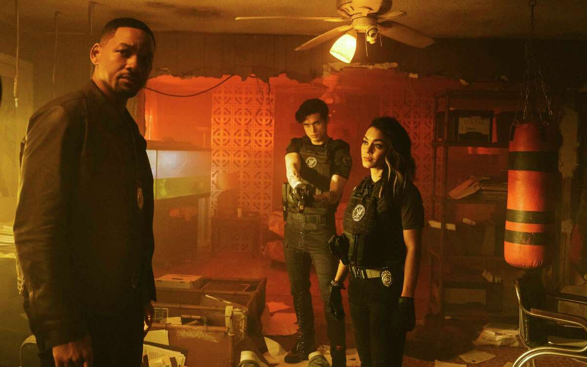 """This image released by Sony Pictures shows Will Smith, from left, Charles Melton and Vanessa Hudgens in a scene from """"Bad Boys for Life."""" (Columbia Pictures-Sony via AP)"""