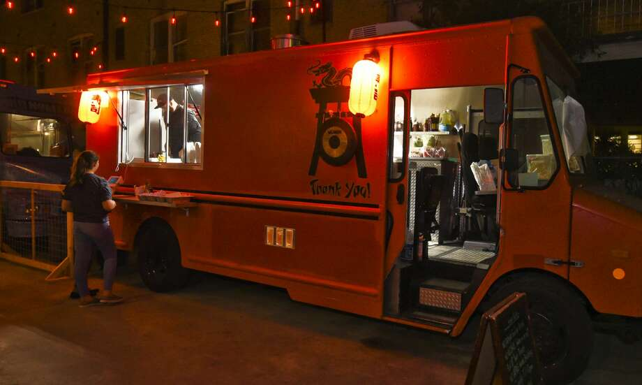 Customers order at Wok-A-Mole food truck at Cultura Beer Garden in this file photo. Photo: Danny Zaragoza/Laredo Morning Times