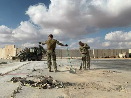 """A file picture taken on Jan. 13, 2020 during a press tour organized by the U.S.-led coalition fighting the remnants of the Islamic State group, shows U.S. soldiers clearing rubble at Ain al-Asad military airbase in the western Iraqi province of Anbar. Nearly three dozen US troops suffered traumatic brain injuries or concussion in the recent Iranian air strike on a military base in Iraq housing American personnel, the Pentagon said on Jan. 24, 2020. """"Thirty-four total members have been diagonosed with concussions and TBI (traumatic brain injury),"""" Pentagon spokesman Jonathan Hoffman told reporters."""