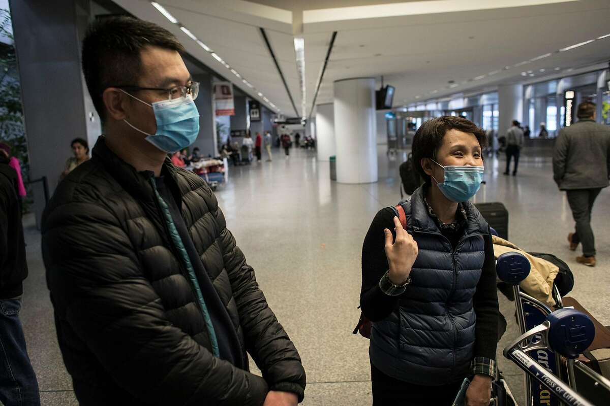 From left, Simon Wu and Michelle Du talk about the tests they had to go through while flying through China. The two said they didn't have any at San Francisco Airport's international terminal on January 30, 2020 in San Francisco, Calif. Airlines are cancelling some flights to China because of concerns over the coronavirus.