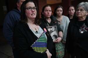 File photo of Jennifer Lawlor, left, mother of Emily Todd, speaks outside Superior Court in Bridgeport, Conn., on Tuesday, Jan. 28, 2020.