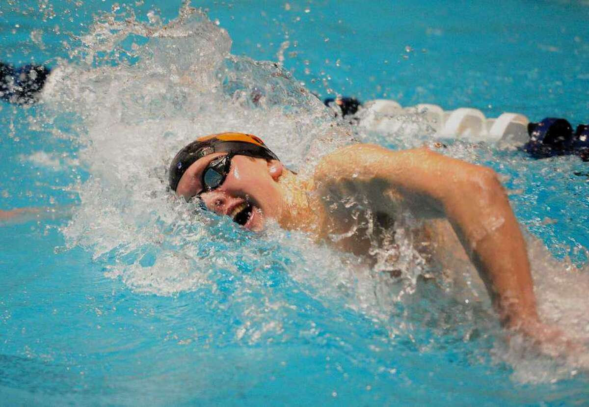 Ridgefield High sophomore Connor Hunt swims to victory in the 500-yard freestyle at the State Open.