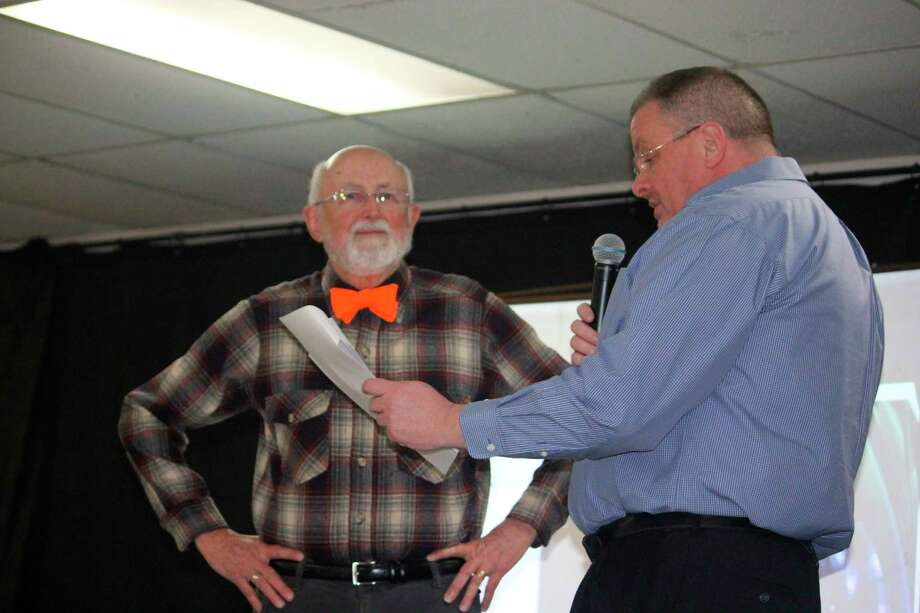 Robert Palmer (left) listens as the Pioneer's Ben Montgomery talks about the 78-year-old Big Rapids resident's hunting season during Tuesday's Sportsman's Dinner. (Pioneer photo/John Raffel)