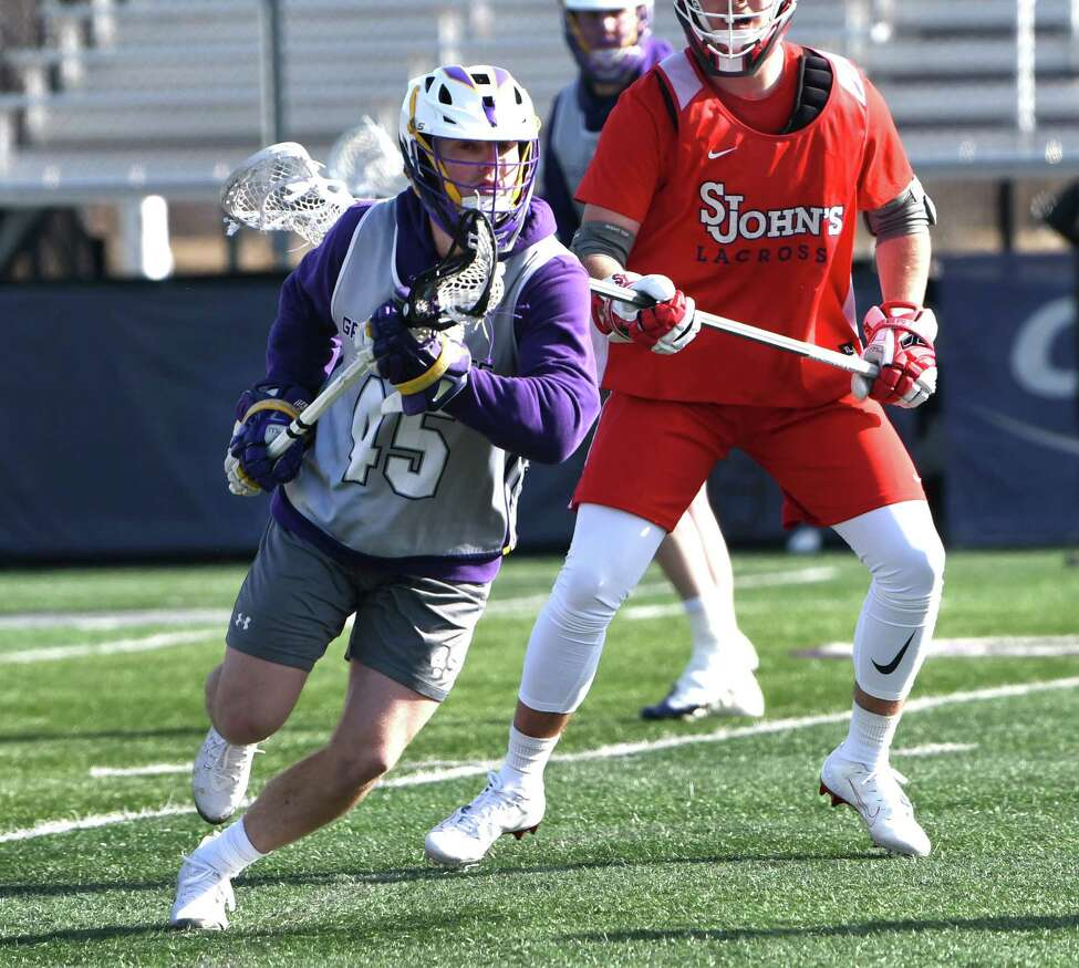 University at Albany Graydon Hogg (45) carries the ball during a scrimmage with St. John's at Casey Stadium on Thursday, Jan. 30, 2020 in Albany, N.Y. (Lori Van Buren/Times Union)
