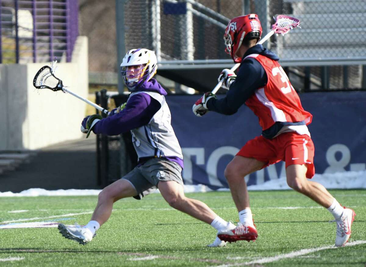 University at Albany's Graydon Hogg, left, seen during a scrimmage lacrosse game with St. John's at Casey Stadium on Thursday, Jan. 30, 2020 in Albany, N.Y. (Lori Van Buren/Times Union)