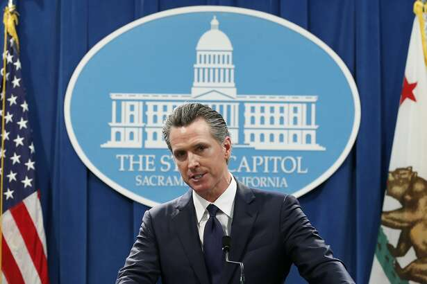 FILE - In this Jan. 10, 2020, file photo, California Gov. Gavin Newsom speaks at a news conference in Sacramento, Calif. Newsom is urging a federal judge to reject Pacific Gas and Electric's blueprint for getting out of bankruptcy and renewing his threat to lead a bid to turn the beleaguered utility into a government-run operation. PG&E is trying to dig out of a financial hole created by more than $50 billion in claims stemming from a series of catastrophic wildfires that have been blamed on the San Francisco company. (AP Photo/Rich Pedroncelli, File)