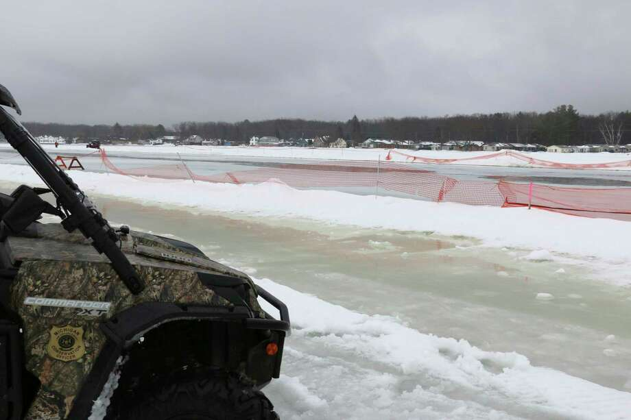 Ice conditions at Houghton Lake were very slushy during the 70th Tip-Up Town -- an annual winter festival in Roscommon County.Picturedis the snowmobile track where sprint races took place Jan. 25. (Photo provided by Michigan DNR)