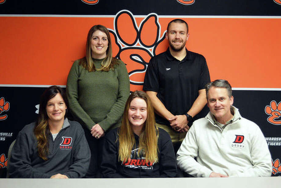Edwardsville senior Josie Bushell, seated center, will compete in swimming for Drury University in Springfield, Missouri. She is seated with her parents, Laura and Vince Bushell, and joined by EHS assistant coach Sam Kistner and EHS head coach Christian Rhoten, Photo: Scott Marion/The Intelligencer