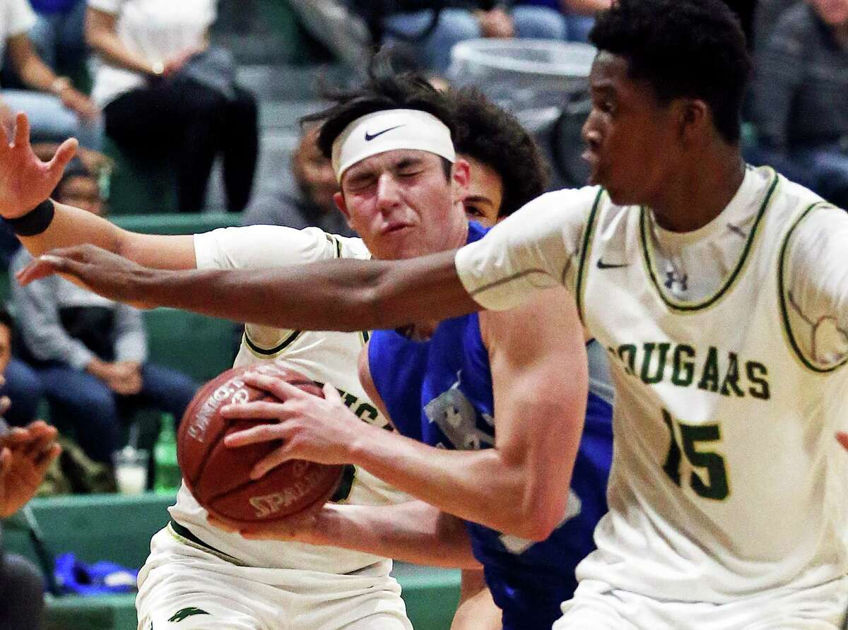 Ro-Hawk forward Logan Bracamonte presses the ball into the lane against the Cougar's Vincent Iwuchukwu as Cole hosts Randolph in the District 26-3A high school boys basketball opener on Jan.17, 2020.