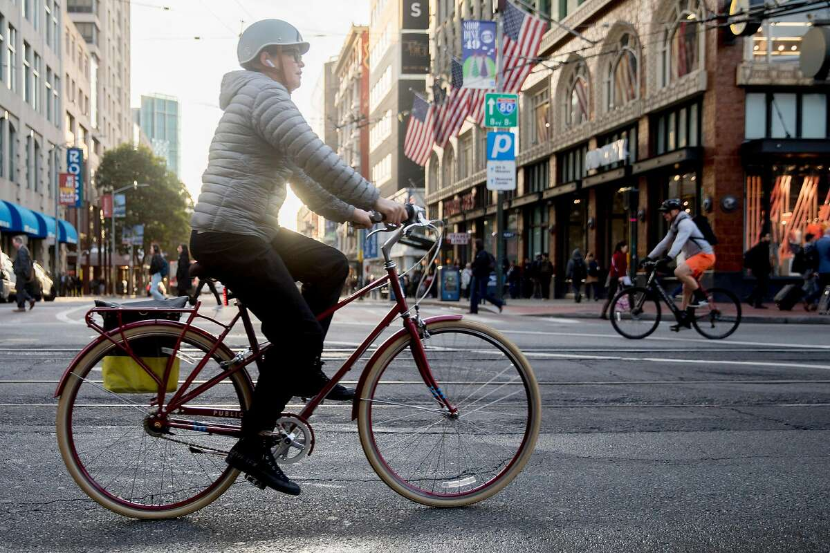 Cyclists move freely up and down Market Street in San Francisco, Calif. Wednesday, January 29, 2020. Beginning January 29, private vehicles will be banned from driving along Market Street between Steuart and 10th streets, leaving it free for cyclists, pedestrians and public transit vehicles.