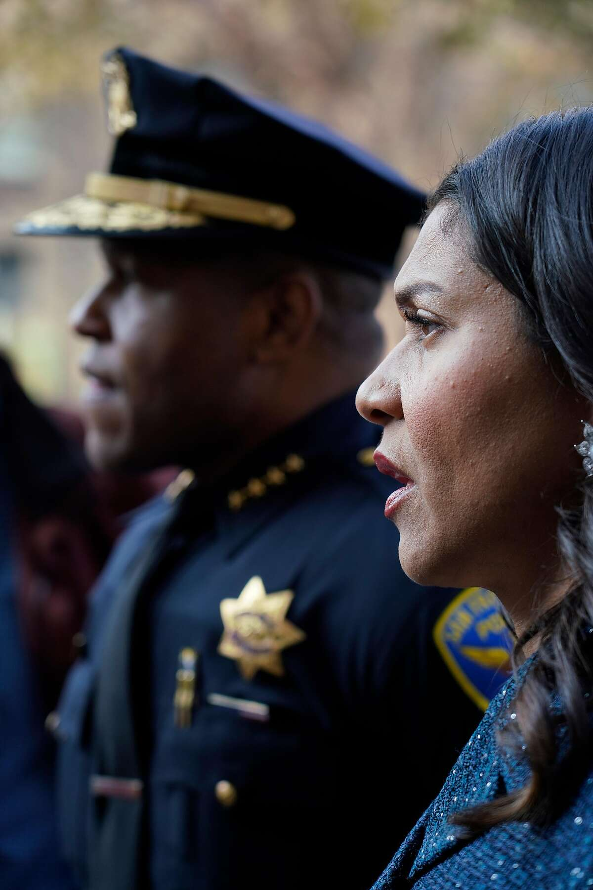 """Mayor London Breed (right) and San Francisco Police Chief Bill Scott (left) look down Market Street while out walking with a Healthy Streets Operation Center team in a new program called �Healthy Streets Intervention"""" on Wednesday, November 14, 2018 in San Francisco, Calif."""