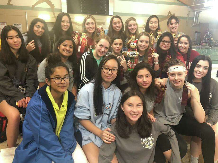 The Dulles girls swimming and diving team won the District 20-6A championship, led by five individual gold medals and a relay victory. Photo: Courtesy Of Dulles High School / Dulles High School