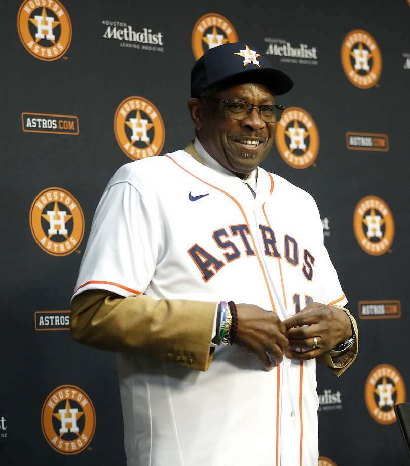 Dusty Baker reacts after putting on his Houston Astros baseball cap, as owner Jim Crane introduced him as the Astros new manager at Minute Maid Park, in Houston, Thursday, Jan. 30, 2020. Photo: Karen Warren, Staff Photographer