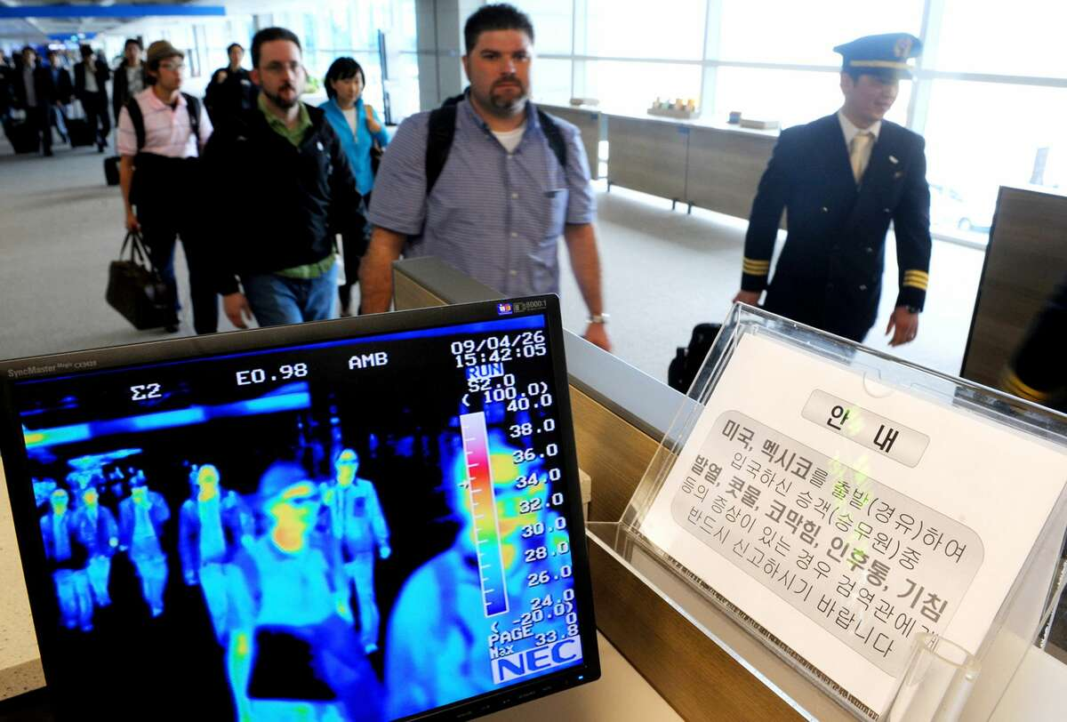 A thermal camera system monitors the body heat of passengers passing through checkpoints looking for possible infections at many airports around the world.
