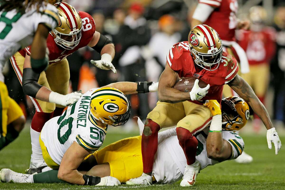 San Francisco 49ers running back Raheem Mostert (31) fights for extra yards against Green Bay Packers defensive tackle Kingsley Keke (96) in the NFC Championship Game at Levi's Stadium, Sunday, Jan. 19, 2020, in San Francisco, Calif. The San Francisco 49ers won 37-20 against the Green Bay Packers. The 49ers will play the Kansas City Chiefs in the Super Bowl.