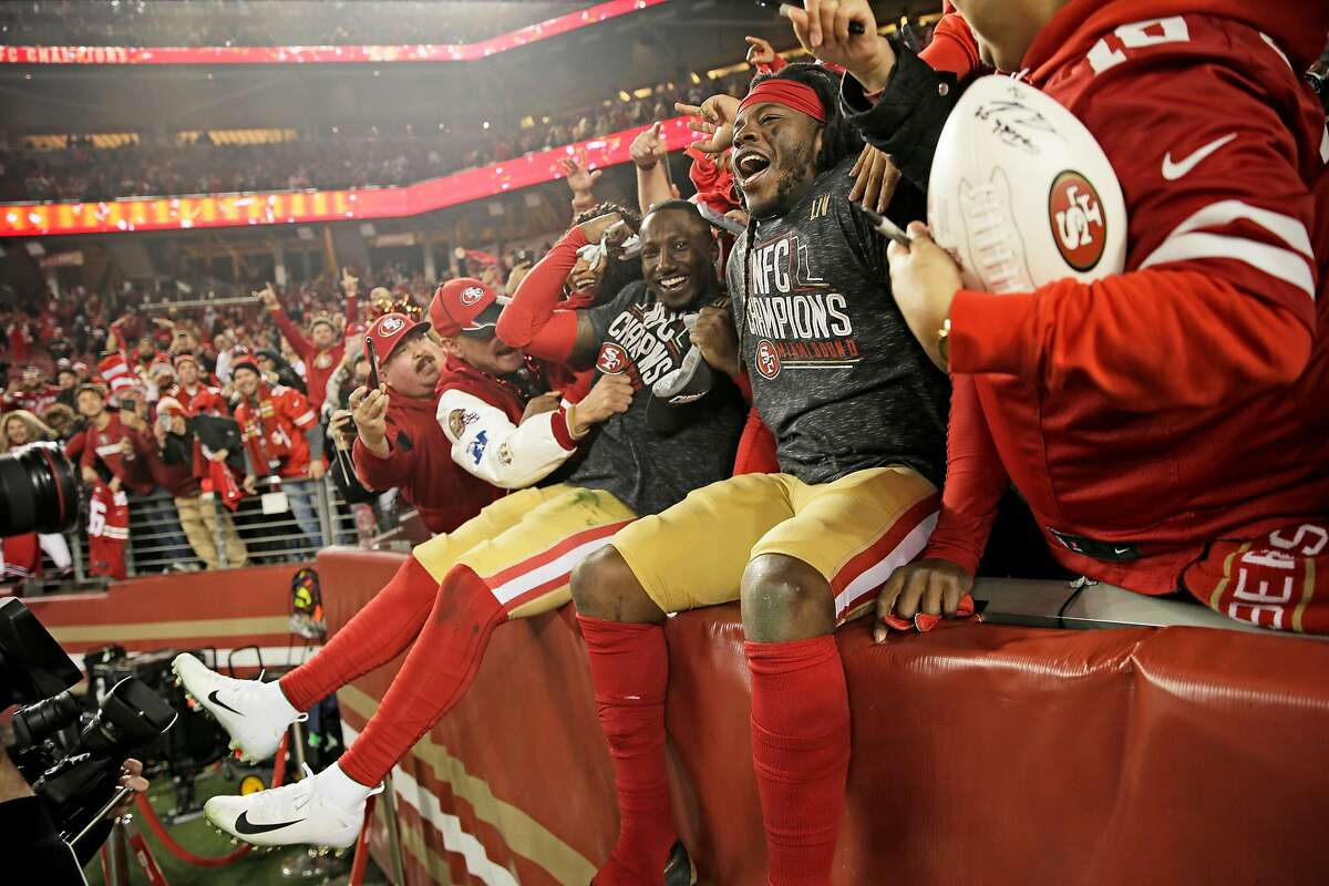 From left: San Francisco 49ers wide receiver Deebo Samuel (19) and 49ers defensive back Marcell Harris (36) jump into the crowd following the NFC Championship Game at Levi's Stadium, Sunday, Jan. 19, 2020, in San Francisco, Calif. The San Francisco 49ers won 37-20 against the Green Bay Packers. The 49ers will play the Kansas City Chiefs in the Super Bowl.