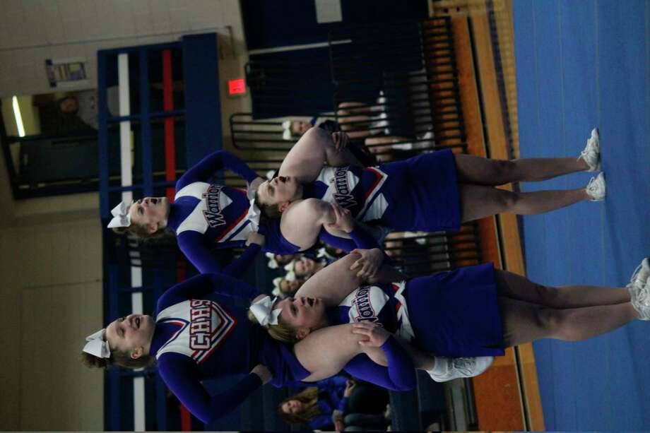 Performing during round 3 at Wednesday's home cheer meet for Chippewa Hills were: top: Abigayle Loomis and Bailey Loomis; bottom, Margo Sisco and Isabel Werner. (Pioneer photo/John Raffel)