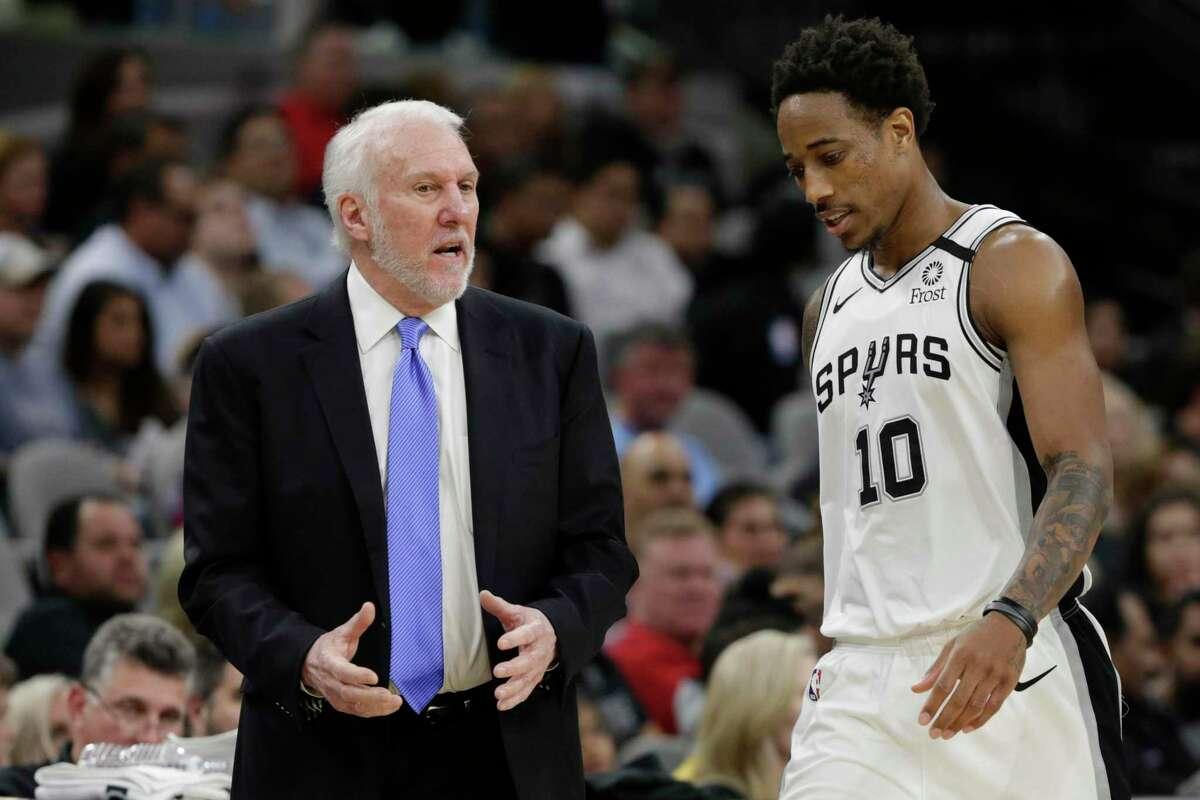 San Antonio Spurs head coach Gregg Popovich, left, talks with forward DeMar DeRozan (10) during the second half of an NBA basketball game against the Utah Jazz in San Antonio, Wednesday, Jan. 29, 2020. (AP Photo/Eric Gay)