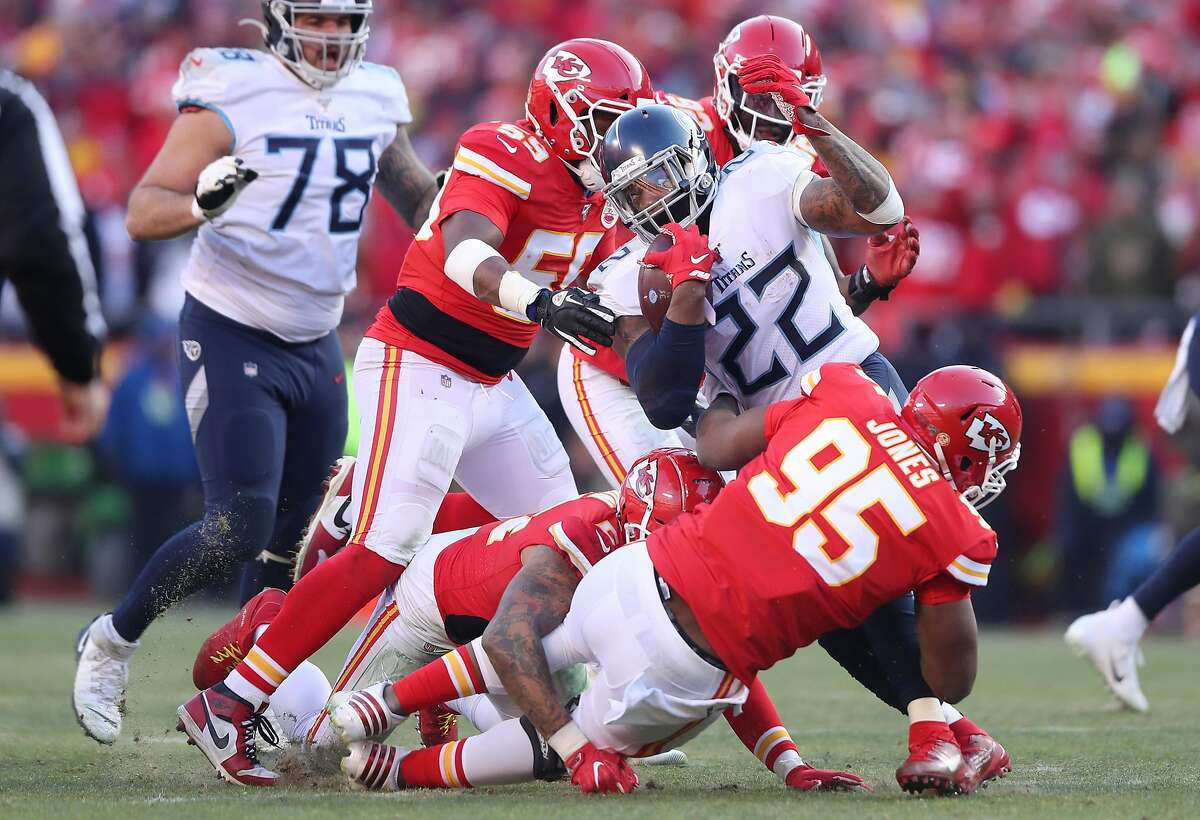 KANSAS CITY, MISSOURI - JANUARY 19: Derrick Henry #22 of the Tennessee Titans runs with the ball in the first half against the Kansas City Chiefs in the AFC Championship Game at Arrowhead Stadium on January 19, 2020 in Kansas City, Missouri. (Photo by Matthew Stockman/Getty Images)