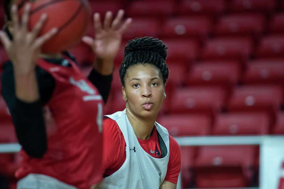 Micaela Wilson keeps her eye on the ball as she practices with the Lady Cardinals on January 30, 2020 even though she is sitting out the season due to NCAA transfer rules.