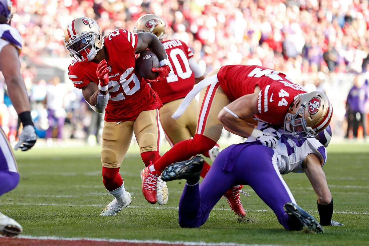 San Francisco 49ers' Tevin Coleman rushes for a 2nd quarter touchdown behind a block by Kyle Juszczyk during 27-10 win over Minnesota Vikings during NFC Divisional playoff game at Levi's Stadium in Santa Clara, Calif., on Saturday, January 11, 2020.