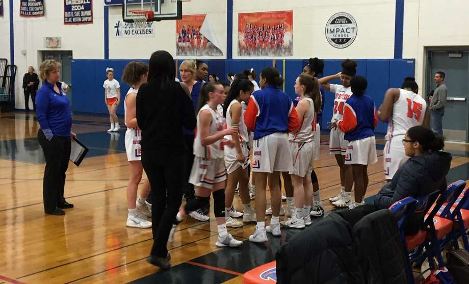 Danbury coach Jackie DiNardo talks to her players during a timeout in Thursday's 41-40 win over Wilton. Photo: Tim Murphy / Hearst Connecticut Media