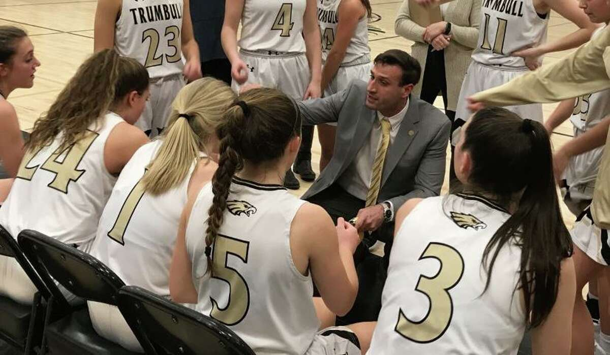 Trumbull coach Steve Tobitsch counsels his team during game with Norwalk.