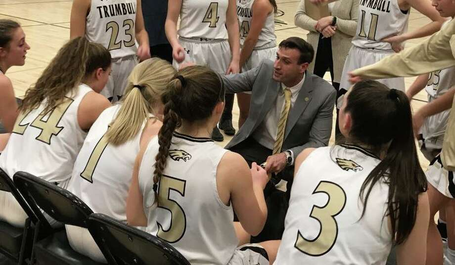 Trumbull coach Steve Tobitsch counsels his team during game with Norwalk. Photo: Bill Bloxsom / Hearst Connecticut Media / Trumbull Times